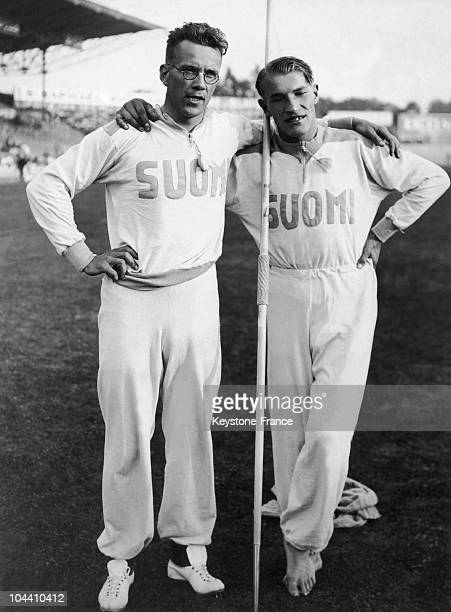Finnish athletes Matti JARVINEN and Yrjo NIKKANEN, having landed first and second place in the javelin throw, pose during the European Track and...