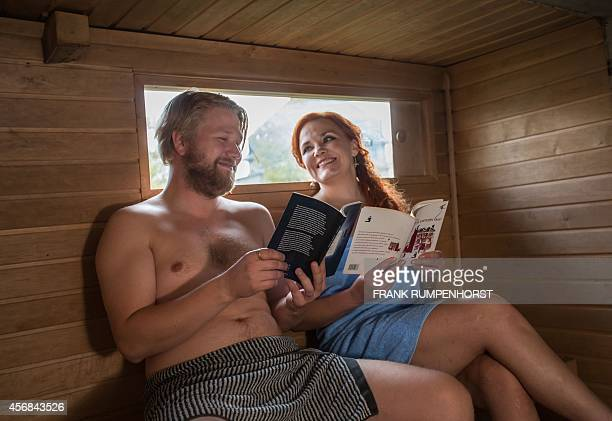Finnish authors Harri Hertell and Katariina Vuorinen give a reading in a mobile sauna on October 8 2014 on the sidelines of the book fair in...