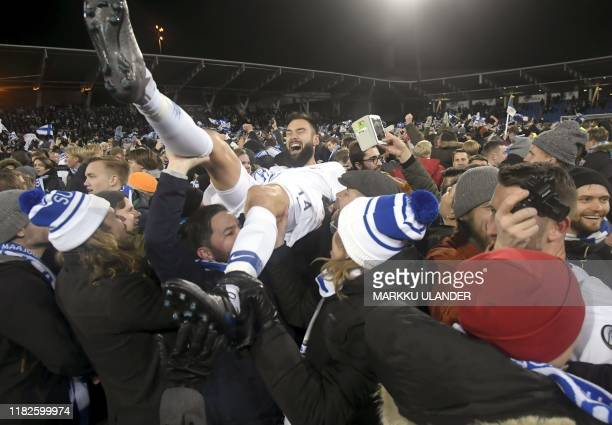 Finnish captain Tim Sparv celebrates with fans after the UEFA Euro 2020 Group J qualification football match between Finland and Liechtenstein in...