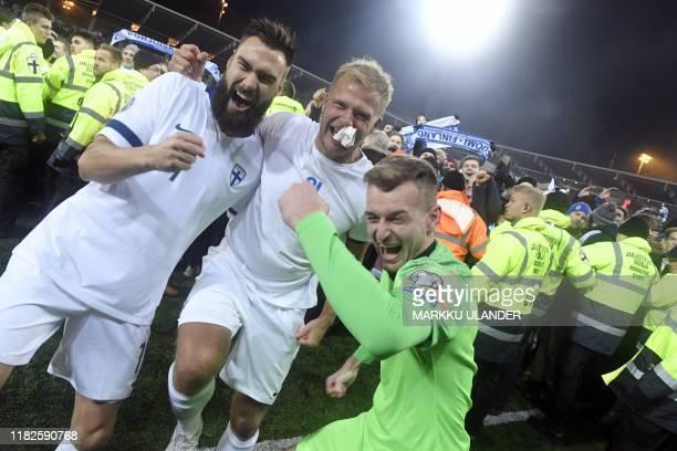 Finnish captain Tim Sparv celebrates with Paulus Arajuuri and goalkeeper Lukas Hradecky after the UEFA Euro 2020 Group J qualification football match...