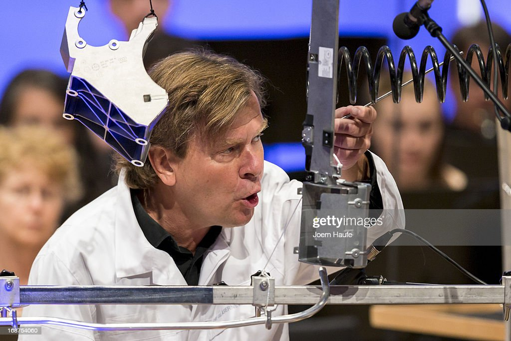 Finnish composer and pianist Magnus Lindberg performs with the New York Philharmonic his composition 'Power' by using car parts as musical instruments at the Volkswagen Phaeton factory on May 14, 2013 in Dresden, Germany. The event took place as part of the current Dresden Music Festival (Dresdner Musikfestspiele) and the musicians also played classical pieces on regular instruments later in the evening.