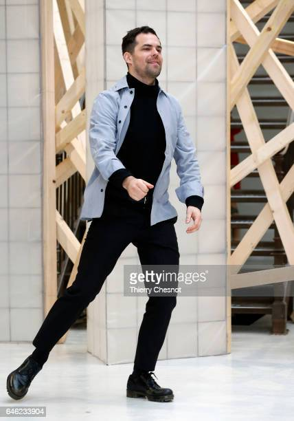 Finnish designer Tuomas Merikoski acknowledges the audience after presentingt his Aalto show as part of the Paris Fashion Week Womenswear Fall/Winter...