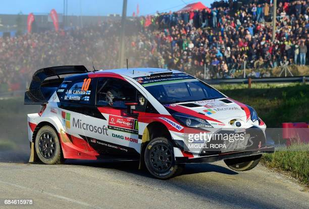 TOPSHOT Finnish driver and codriver Jari Matti Latvala and Miikka Anttila steer their Toyota Yaris WRC in Lousada on May 18 during the Super Special...