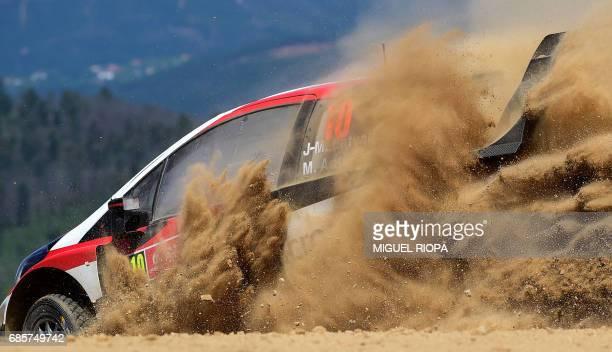 Finnish driver and codriver Jari Matti Latvala and Miikka Anttila steer their Toyota Yaris WRC in Amarante northern Portugal on May 20 during the...