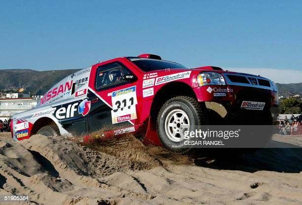 Finnish driver Ari Vatanen and co-driver Tiziano Siviero of the Nissan Rally Raid Team race during the Barcelona-Dakar rally's first stage in...
