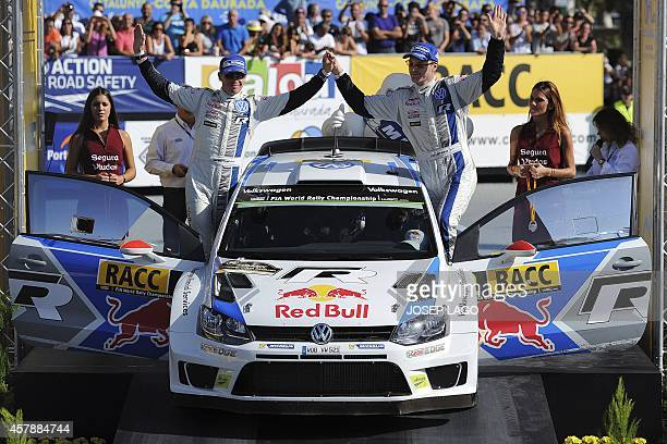 Finnish driver JariMatti Latvala and codriver Miikka Anttila celebrate after taking second place of the 50th Rally of Catalonia in Salou near...