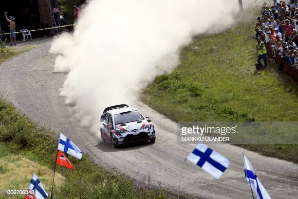 Finnish driver JariMatti Latvala and codriver Miikka Anttila steer their Toyota Yaris WRC during the Kakaristo Special Stage of the WRC Rallye...