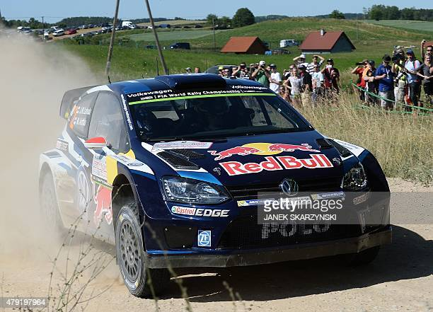 Finnish driver JariMatti Latvala and codriver Miikka Anttila steer their Wolkswagen Polo R WRC on July 2 2015 in Mikolajki north Poland during the...