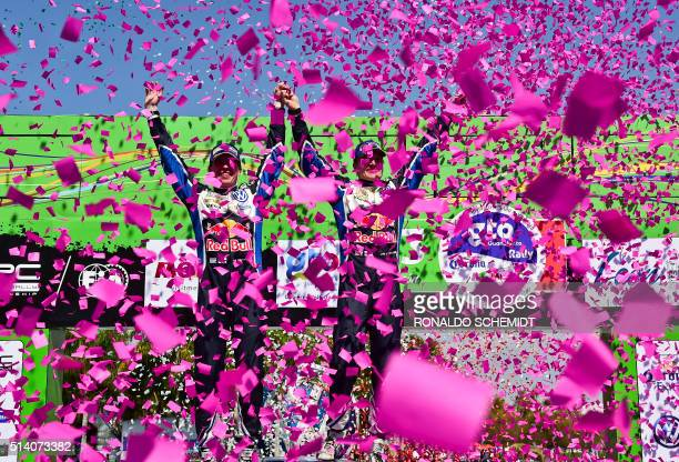 TOPSHOT Finnish driver JariMatti Latvala and codriver Miikka Anttila celebrate their victory in the 2016 FIA World Rally Championship in Guanajuato...