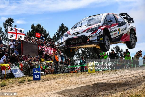 Finnish driver JariMatti Latvala and Finnish codriver Miikka Anttila steer their Toyota Yaris WRC during the Micky's Jump at Monte Lerno as part of...