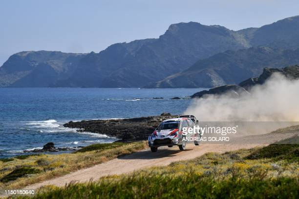 Finnish driver JariMatti Latvala and Finnish codriver Miikka Anttila steer their Toyota Yaris WRC during the Argentiera SS17 stage on the fourth day...