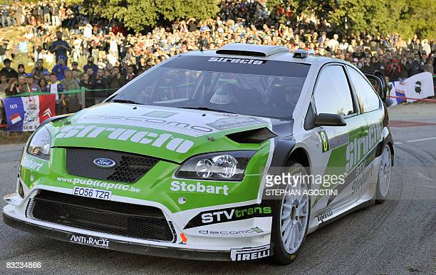 Finnish driver JariMatti Latvala and his teammate Miikka Anttila steer their Ford Focus RS WRC during the 52th Rally of FranceTour de Corse third leg...