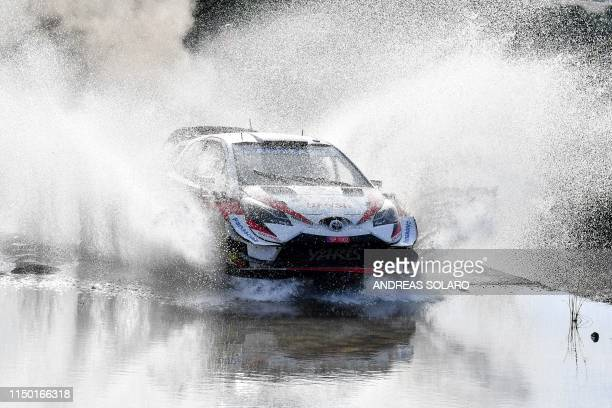 Finnish driver Juho Hanninen and codriver Tomi Tuominen steer their Toyota Yaris WRC during the Ford of Filigosu river crossing at Monte Lerno as...