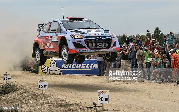 Finnish driver Juho Hanninen and copilot Tomi Tuominen jump their Hyndai i20 WRC as they compete during the fourth special stage SS4 of the FIA World...