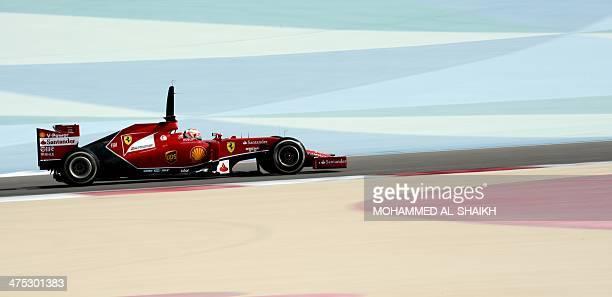 Finnish driver Kimi Raikkonen of Scuderia Ferrari team drives on February 27 2014 during a fourday testing period at Bahrain's Sakhir circuit ahead...