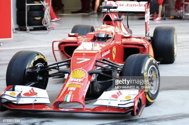 Finnish driver Kimi Raikkonen of Scuderia Ferrari team sits in his car on February 27 2014 during a fourday testing period at Bahrain's Sakhir...