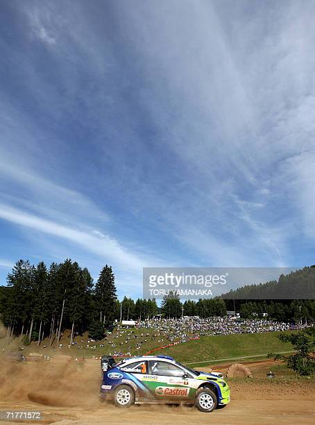Finnish driver Marcus Gronholm and codriver Timo Rautiainen speed their Ford Focus RS WRC 2006 during the special stage 16 in the Japanese round of...