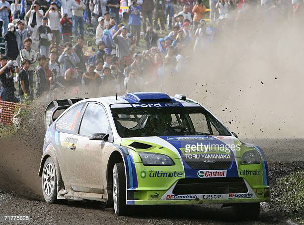 Finnish driver Marcus Gronholm and codriver Timo Rautianen in their Ford Focus RS 2006 negotiate a corner during the special stage 23 in the Japanese...