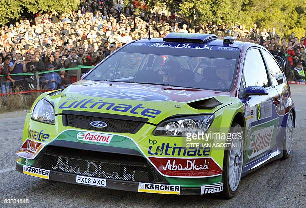 Finnish driver Mikko Hirvonen and his teammate Jarmo Lehtinen steer their Ford Focus RS WRC during the 52th Rally of FranceTour de Corse third leg...