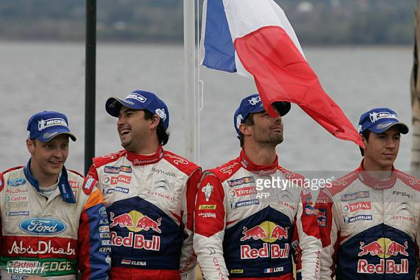 Finnish driver Mikko Hirvonen Daniel Elena from Monaco and Frenchmen driver Sebastien Loeb and Julien Ingrassia stand at the final podium of the WRC...