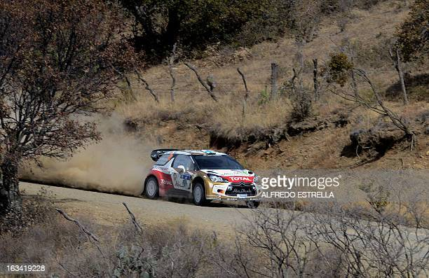 Finnish driver Mikko Hirvonen of Citroen Total Abu Dhabi Team competes during the second day of the FIA World Rally Championship at the Speedway of...