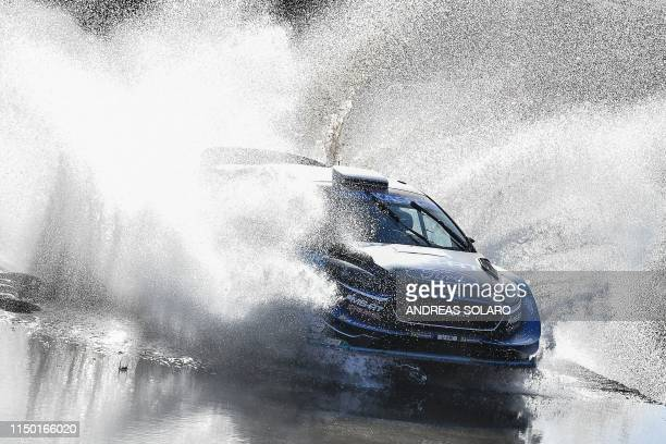 """Finnish driver Teemu Suninen and Finnish co-driver Marko Salminen steer their Ford Fiesta WRC during the """"Ford of Filigosu"""" river crossing at Monte..."""