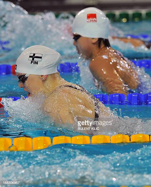 Finnish Emilia Pikkarainen competes during the Women 100m individual medley qualification on December 13 2012 at the FINA World Short Course Swimming...