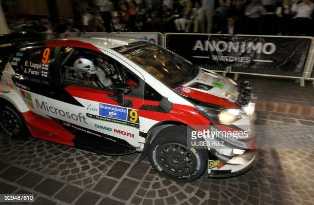 Finnish Esapekka Lappi and codriver Janne Ferm steer their Toyota Yaris WRC for the start of the 2018 FIA World Rally Championship on the streets and...