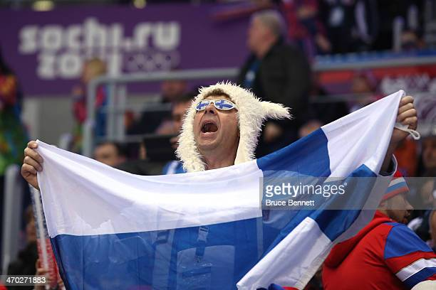 Finnish fan holds up a flag during the Men's Ice Hockey Quarterfinal Playoff between Finland and Russia on Day 12 of the 2014 Sochi Winter Olympics...