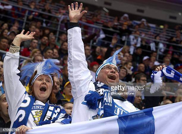 Finnish fans celebrate a goal by their team against Sweden in the second period of a men's hockey semifinal at Bolshoy Ice Dome during the Winter...