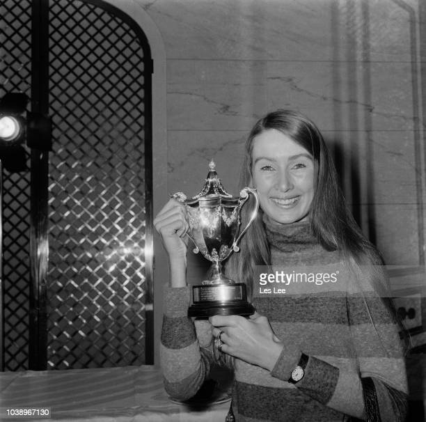 Finnish fashion model Nina Rindt with racing driver's trophy received on behalf of her husband Jochen Rindt who was killed in a crash at Monza in...
