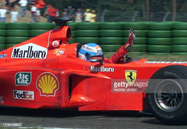 Finnish Ferrari driver Mika Salo celebrates after he finished second at the German Formula One Grand Prix O1 August 1999 at Hockenheim behind...