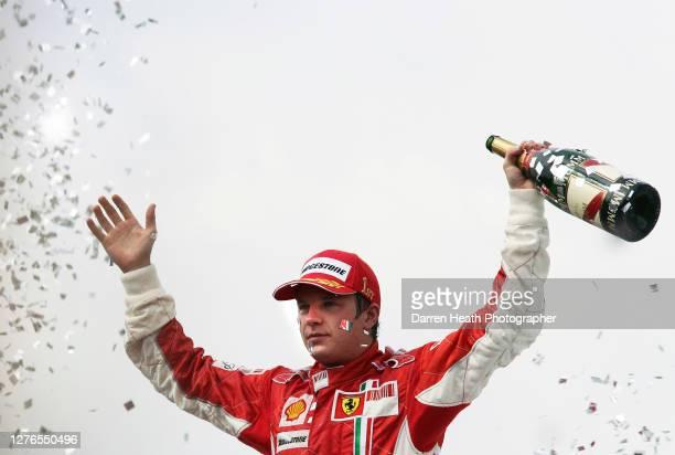 Finnish Ferrari Formula One driver Kimi Raikkonen on the podium celebrating winning the 2007 Brazilian Grand Prix held at the Autodromo José Carlos...