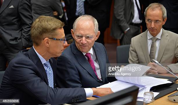 Finnish Finance Minister Alexander Stubb and German Finance Minister Wolfgang Schauble talk at the start of the Eurogroup finance ministers meeting...