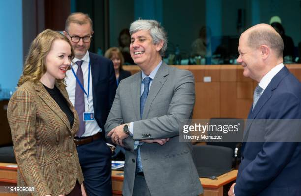 Finnish Finance Minister Katri Briitta Ilona Kulmuni is talking with the Portuguese Finance Minister, President of the group Mario Centeno and the...