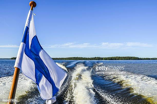 Finnish Flag By Sea Against Sky