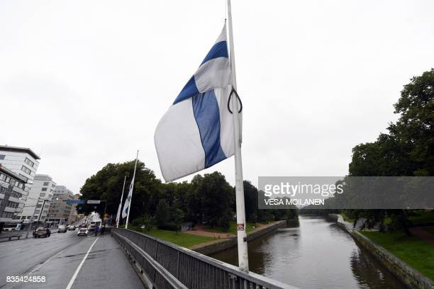 A finnish flag flies at halfmast in Turku Finland on August 19 2017 Two people were killed and six were injured in a stabbing spree in the Finnish...