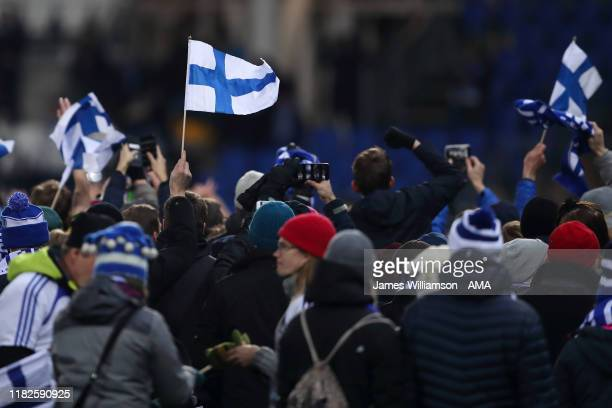 Finnish flags are waved by fans at full time as they celebrate qualification for Euro 2020 at the UEFA Euro 2020 Qualifier between Finland and...