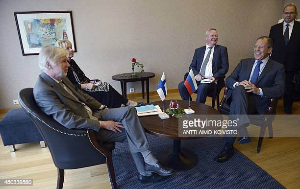 Finnish Foreign Minister Erkki Tuomioja and Russian Foreign Minister Sergei Lavrov Russia's Deputy Minister of Foreign Affairs Vladimir Titov pose...