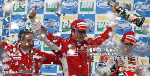 STORY Finnish Formula One driver Kimi Raikkonen celebrates with Ferrari team mananger Jean Todt and Spanish Fernando Alonso his F1 World Champion...