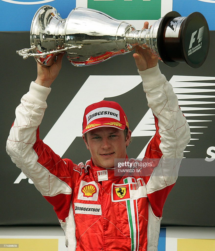 Finnish Formula One driver Kimi Raikkonen of Ferrari holds his F1 World Championship trophy during the podium ceremony of Brazil's GP, 21 October 2007 at the Interlagos racetrack in Sao Paulo, Brazil. Raikkonen won both the World Championship title and the race. Brazilian Felipe Massa arrived in second place followed by Spanish Fernando Alonso.