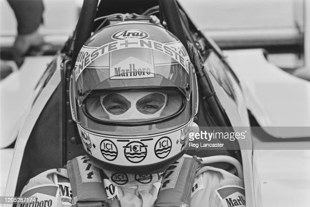 Finnish Formula One racing driver Keke Rosberg, driver with the Williams Formula One team, at the wheel of his race car during testing of the new...