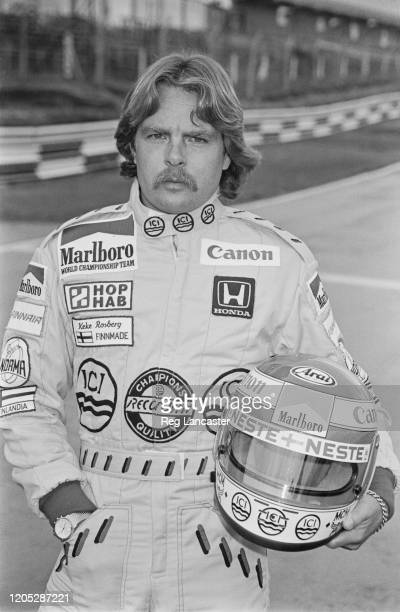 Finnish Formula One racing driver Keke Rosberg, driver with the Williams Formula One team, United Kingdom, holding his helmet in his left arm, during...