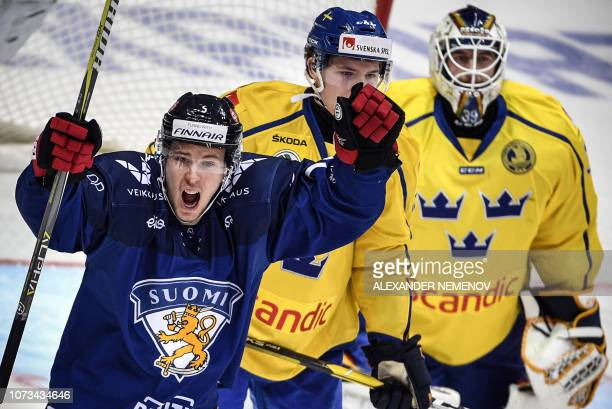 Finnish forward Antii Junttila celebrates a goal during the Channel One Cup of the Euro Hockey Tour ice hockey match between Sweden and Finland in...