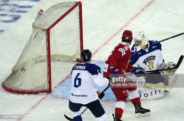 Finnish goalkeeper Joni Ortio eyes the puck in his net during the Channel One Cup of the Euro Hockey Tour ice hockey match between Russia and Finland...