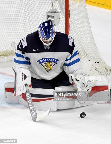 Finnish goalkeeper Joonas Korpisalo catches the puck during the Ice Hockey World Championship thirdplace match between Finland and Russia in the...
