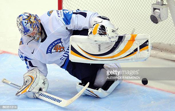 Finnish goaltender Pekka Rinne lets a puck into his net during a penalty shoot-out in a qualifying round group F game of the IIHF Internetional Ice...
