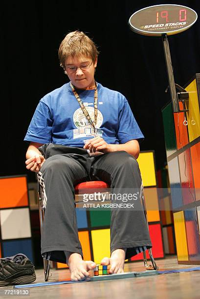 Finnish gold medalist Anssi Vanhala solves a Ribik's cube by feet on the final day of the 2007 Rubik's Cube World Championships in the feet category...