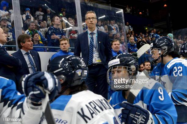 Finnish head coach Pasi Mustonen and players react after their 21 shootout loss in the IIHF Women's Ice Hockey World Championships final match...