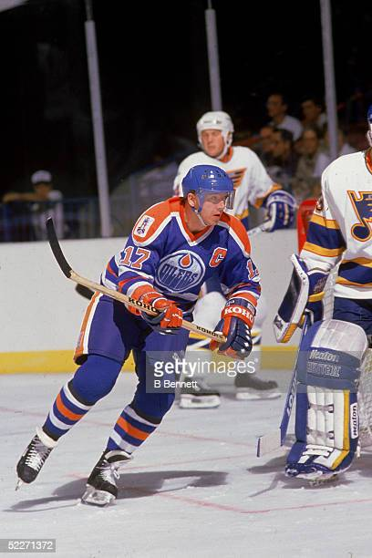Finnish hockey player Jari Kurri in the uniform of the Edmonton Oilers skates around the net during a game against the St Louis Blues St Louis...